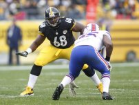 Charles LeClaire: Nov 10, 2013; Pittsburgh, PA, USA; Pittsburgh Steelers tackle Kelvin Beachum (68) prepares to block against Buffalo Bills outside linebacker Jerry Hughes (right) during the second quarter at Heinz Field. The Steelers won 23-10. Mandatory Credit: Charles L